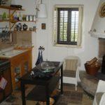 Keuken van Salamandra met open haard